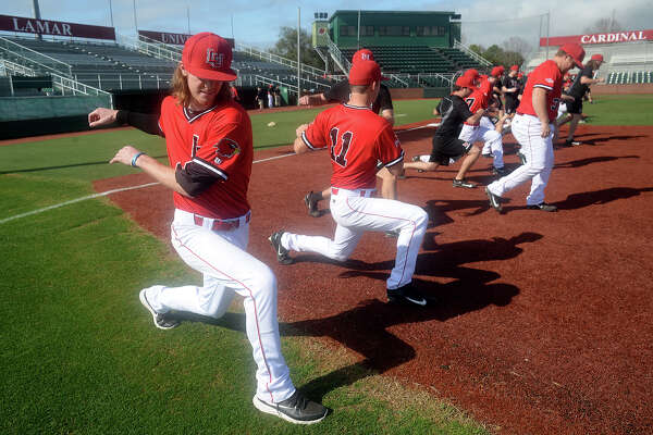 Lamar's Tanner Driskill stretches with teammates before practice as the Cardinals prepare for Sunday's home game. The starting line-up for pitchers has changed recently, with Tanner Driskill slotted to take the leading role. Photo taken Tuesday, February 14, 2017 Kim Brent/The Enterprise