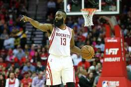Houston Rockets guard James Harden (13) motions to teammates during the second quarter of an NBA game at the Toyota Center Friday, Jan. 20, 2017, in Houston. ( Jon Shapley / Houston Chronicle )