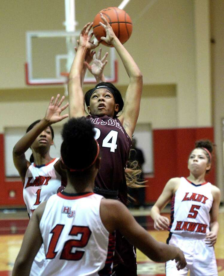 Silsbee's Brandis Bass battles with Hardin-Jefferson's Delberta Gulllory-Smith (#1) and Kelsey Speights for control of the rebound during their area round 4A play-offs match-up in Kountze Thursday. Photo taken Thursday, February 16, 2017 Kim Brent/The Enterprise Photo: Kim Brent