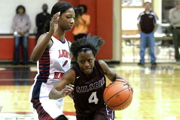 Silsbee's Ashlyn Martin drives past Hardin-Jefferson's Delberta Guillory-Smith during their area round 4A play-offs match-up in Kountze Thursday. Photo taken Thursday, February 16, 2017 Kim Brent/The Enterprise