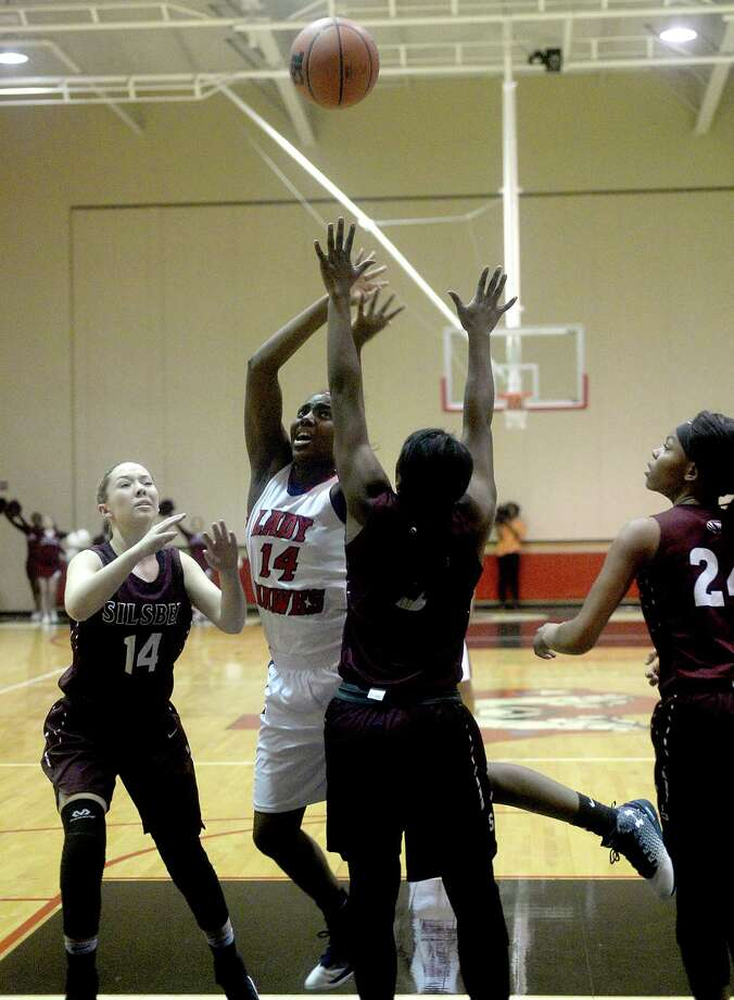 Silsbee's Carley Jones (left) and Symone Carmenar look to block Hardin-Jefferson's shot by Tunisha Strong during their area round 4A play-offs match-up in Kountze Thursday. Photo taken Thursday, February 16, 2017 Kim Brent/The Enterprise Photo: Kim Brent