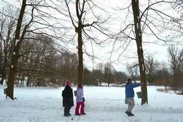 The Tsocanos family of Darien, including Ben, Marianne, 9, and Jacquie, look for a tree to tap at the start of the Adopt-a-Tree maple syrup program at the New Canaan Nature Center, Saturday, Feb. 11, 2017, in New Canaan, Conn.