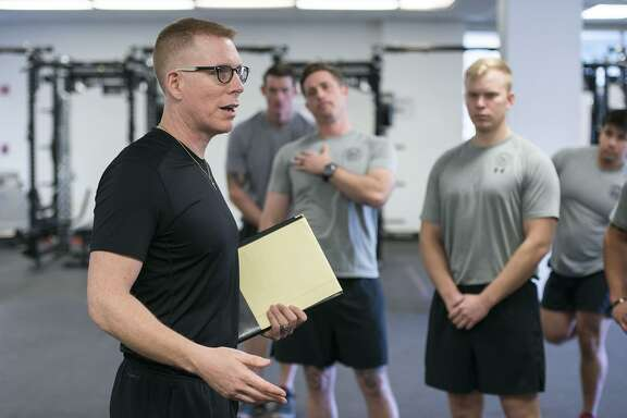 "Tim ""Red"" Wakeham, Michigan State University strength and conditioning coach, speaks to Tactical Air Control Party instructors about kinesiology as he helped to refine their training program Feb. 1 at Joint Base San Antonio-Lackland Medina Annex."