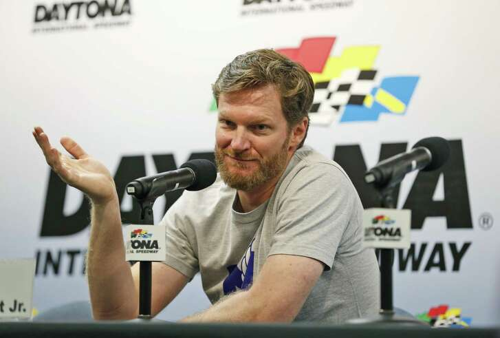 Dale Earnhardt Jr. gestures as he speaks during a news conference before the start of a NASCAR Sprint Cup auto racing practice at Daytona International Speedway, in Daytona Beach, Fla., on June 30, 2016. NASCAR has a new sponsor, a new format and a familiar face this year in its bid to rebound from declining ratings and attendance. The next 11 months will show if Dale Earnhardt Jr., Monster Energy and different rules can provide the needed jolt.