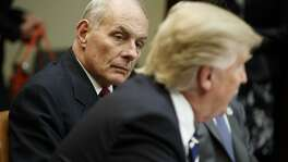 FILE - This is a Tuesday, Jan. 31, 2017 file photo of Homeland Security Secretary John Kelly as he listens at right as President Donald Trump speaks during a meeting on cyber security in the Roosevelt Room of the White House in Washington. Top world leaders, diplomats and defense officials are getting their first opportunity to meet in person with members of President Donald Trump's new administration, amid a laundry list of concerns including the American commitment to the NATO alliance and Washington's posture toward Russia. Vice President Mike Pence, Defense Secretary Jim Mattis and Homeland Security Secretary John Kelly are leading the U.S. delegation to the annual Munich Security Conference.  (AP Photo/Evan Vucci, File)