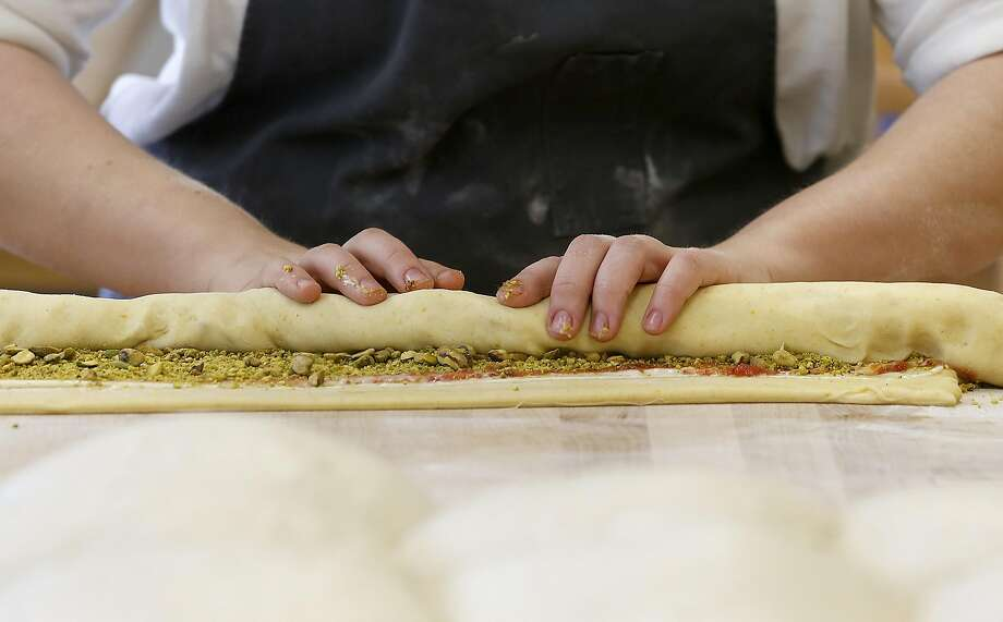 Partner and head baker Avery Ruzicka rolls dough with pistachio, blood orange jam, and other ingredients. Photo: Liz Hafalia, The Chronicle
