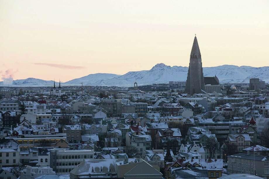 The spire of Hallgrimskirkja church stands above residential and commercial property on the city skyline in Reykjavik, Iceland. Photo: Arnaldur Halldorsson / Bloomberg / © 2016 Bloomberg Finance LP