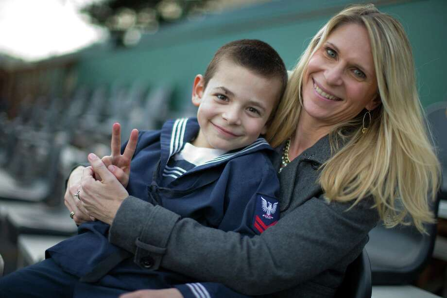 Kristin Vines and her son, Zachery, 6, at Dante Benedetti Baseball Field at USF in San Francisco, Calif., on Wednesday, February 15, 2017. Zachery was saved from a nearly fatal injury by Dr. Peggy Knudsen, after a piece of furniture in the family home fell on him severely injuring his liver. Dr. Knudsen used surgical techniques developed for the military. Photo: Carlos Avila Gonzalez / The Chronicle / San Francisco Chronicle/Carlos Avila Gonzalez