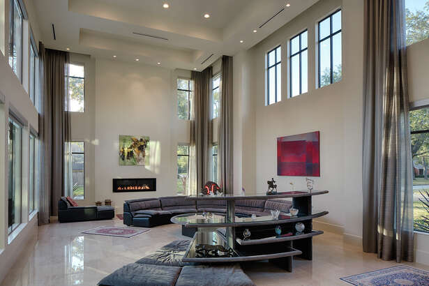 The large sofa required attention to the room's spatial relationships: open space, large windows and a two-story ceiling.