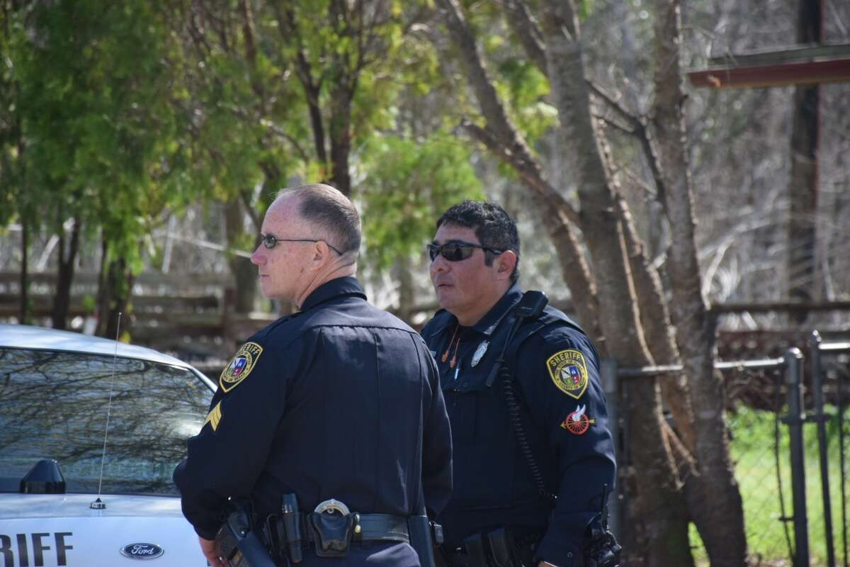 Bexar County deputies search the woods near Salado Creek Greenway for a suspect who they say fled a traffic stop and struck another vehicle Friday, Feb. 17, 2017.
