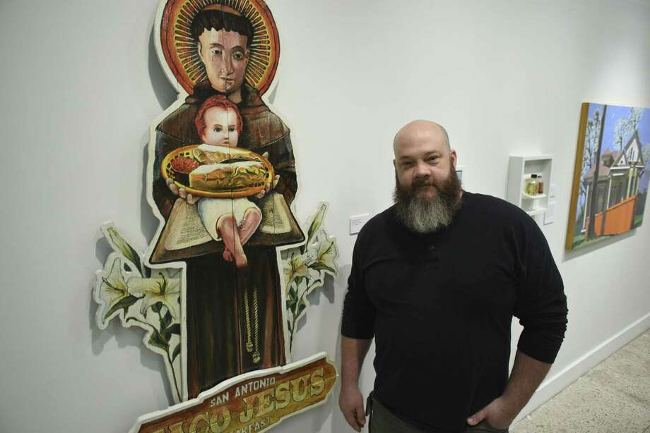 """Taco Jesus"" by Michael Breidenbach, who calls himself Moe Profane, is one of several of his taco-themed works at the ""multiples"" community exhibit at the Galería Guadalupe, which runs through March 31, 2017. Photo: Billy Calzada /San Antonio Express-News / San Antonio Express-News"