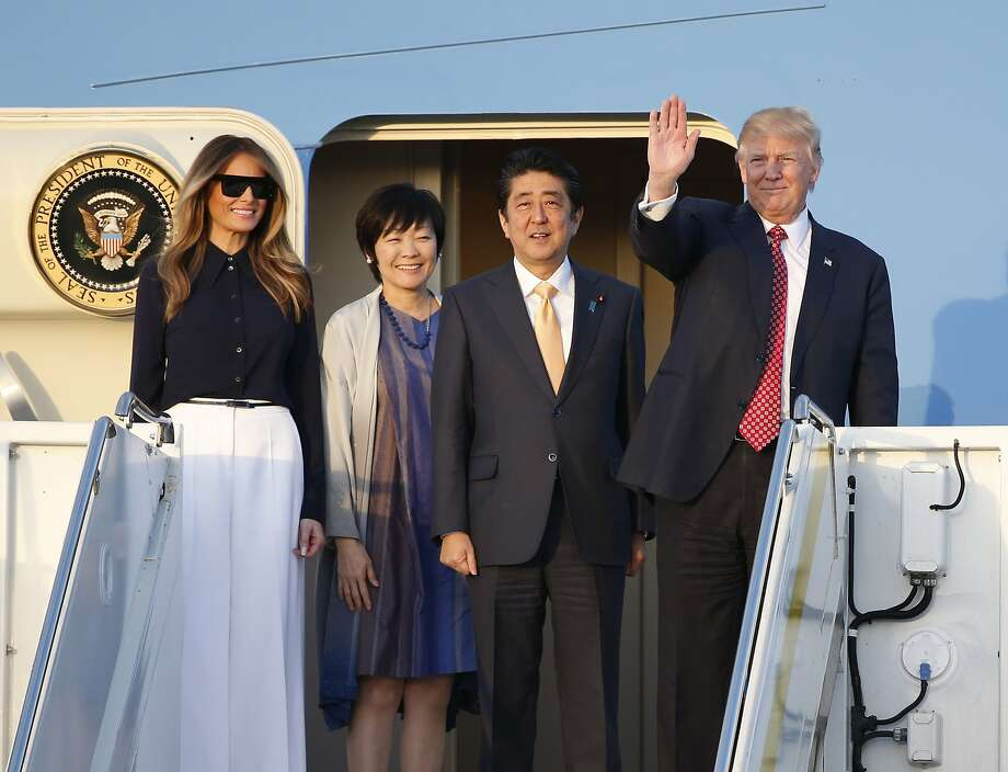President Donald Trump, right, and first lady Melania Trump, left, Japanese Prime Minister Shinzo Abe, second from right, and his wife Akie Abe step off of Air Force One as they arrive in West Palm Beach, Fla., Friday, Feb. 10, 2017. (AP Photo/Wilfredo Lee) Photo: Wilfredo Lee, Associated Press