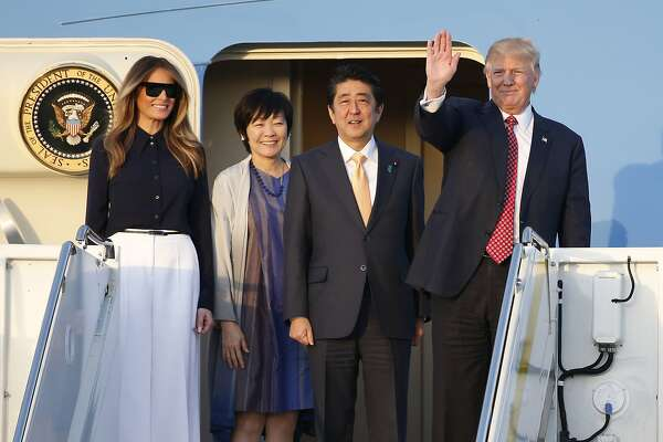 President Donald Trump, right, and first lady Melania Trump, left, Japanese Prime Minister Shinzo Abe, second from right, and his wife Akie Abe step off of Air Force One as they arrive in West Palm Beach, Fla., Friday, Feb. 10, 2017. (AP Photo/Wilfredo Lee)