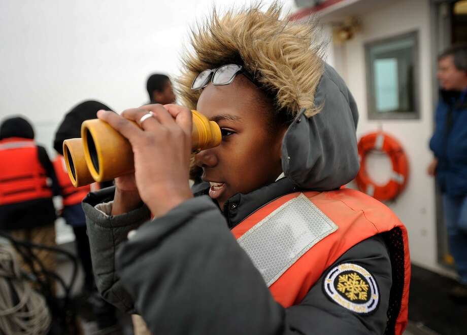 Claytor School sixth grader Clementine Gnoto, 11, of Bridgeport, scans the Sound through binoculars on a trip aboard the research vessel Catherine Moore during a visit to the Aquaculture School in Bridgeport, Conn. on Wednesday, February 15, 2017. Photo: Brian A. Pounds / Hearst Connecticut Media / Connecticut Post