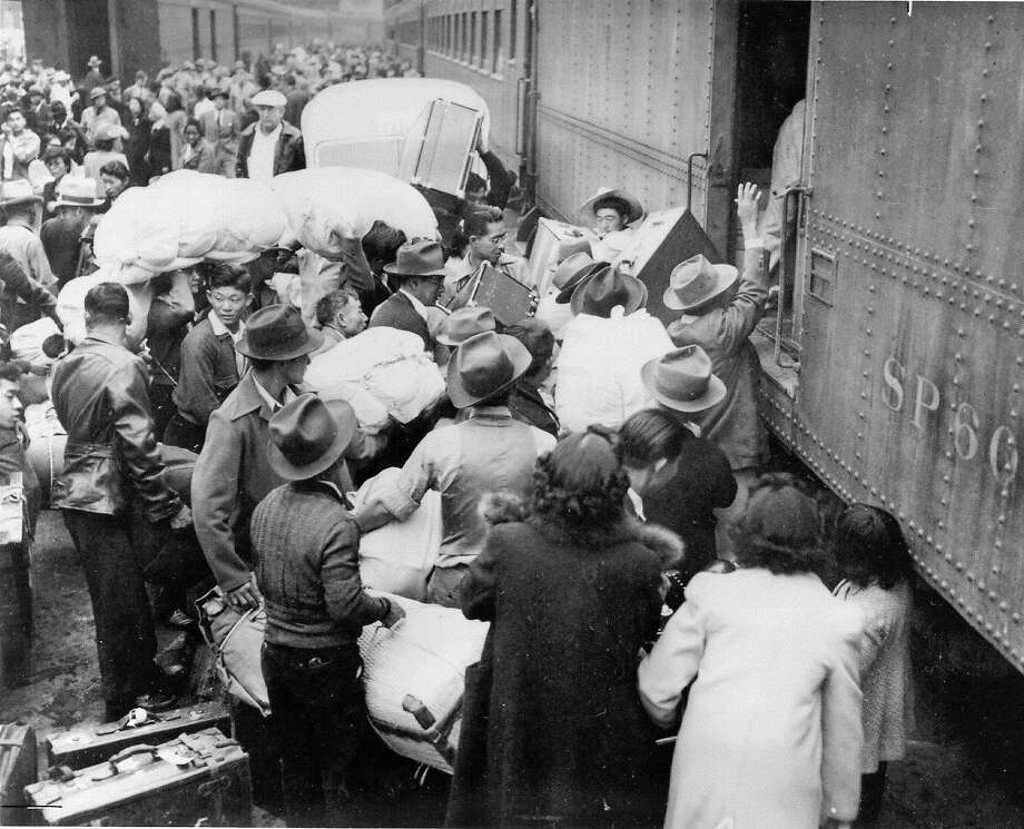 Hundreds of Japanese Americans, allowed to keep only the belongings that they can carry, are forced onto trains bound for internment camps in 1942. Photo: CLEM ALBERS 1942, COURTESY OF THE NATIONAL ARCHIVE