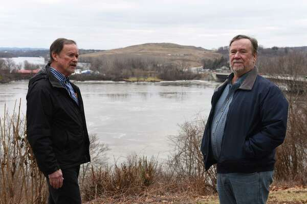 George Harris, left, and Frank Hartley, right, stand on a hilltop overlooking the Mohawk River and Colonie Landfill on Friday, Jan. 20, 2017, in Colonie, N.Y. The neighbors live directly across the river from the dump. (Will Waldron/Times Union)