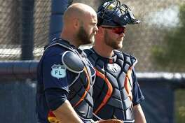 Houston Astros catchers Evan Gattis and Brian McCann during spring training at The Ballpark of the Palm Beaches, in West Palm Beach, Florida, Friday, February 17, 2017.