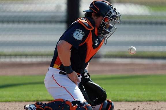 Houston Astros catcher Tyler Heineman bounces a ball off his chest plate during a catching drill during spring training at The Ballpark of the Palm Beaches, in West Palm Beach, Florida, Friday, February 17, 2017.