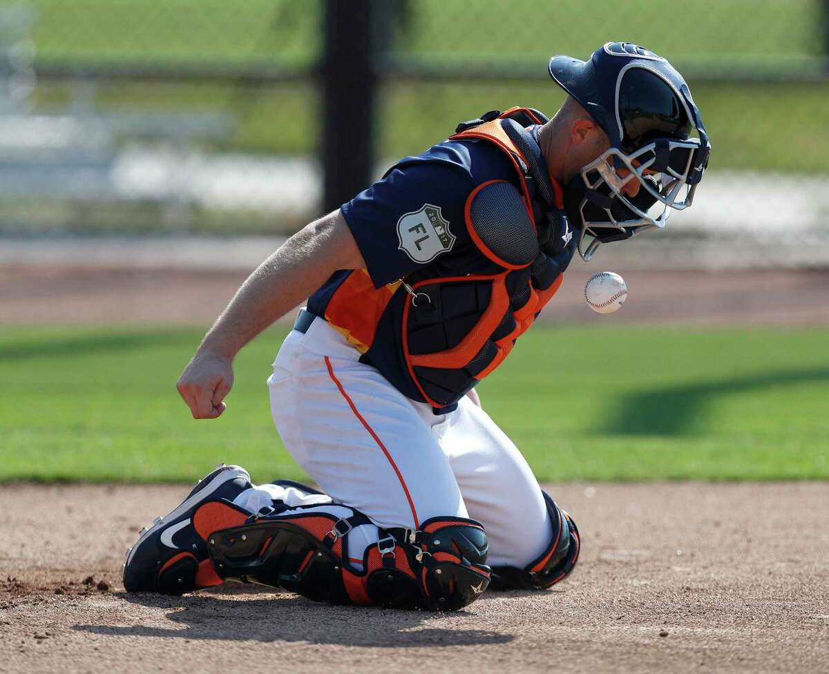 Houston Astros catcher Max Stassi stops a ball with his chest during a catching drill during spring training at The Ballpark of the Palm Beaches, in West Palm Beach, Florida, Friday, February 17, 2017.