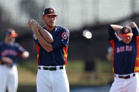 Houston Astros starting pitcher Joe Musgrove stretches during spring training at The Ballpark of the Palm Beaches, in West Palm Beach, Florida, Friday, February 17, 2017.