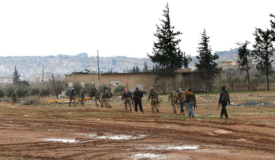 Turkish-backed Syrian fighters advance toward the town of al-Bab, which has been under attack since mid-November and controlled by the Islamic State. Photo: RAFAT AHMAD, AFP/Getty Images