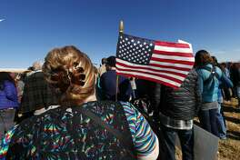 A woman holds an American flag during a rally in support of Jeanette Vizguerra, a Mexican woman seeking to avoid deportation from the United States, outside the Immigration and Customs Enforcement office Wednesday, Feb. 15, 2017, in Centennial, Colo. U.S. immigration authorities have denied Vizguerra's request to remain in the country. (AP Photo/David Zalubowski)