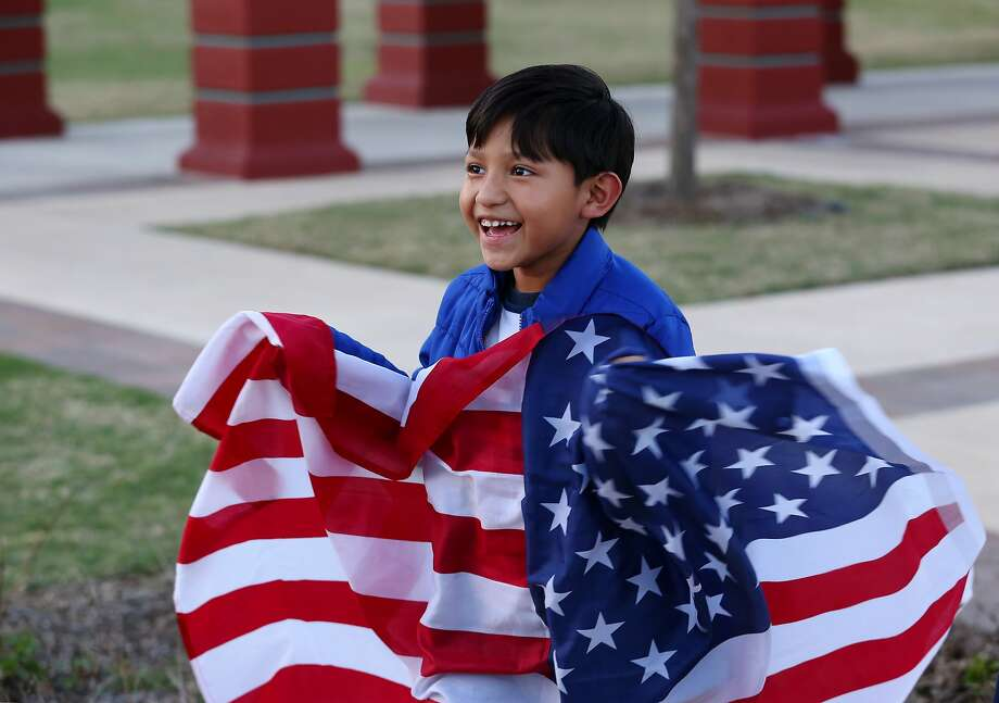 """Melvin Lopez, 7, brings an American flag to participate the """"Day Without Immigrants"""" protest with his family at Guadalupe Plaza Thursday, Feb. 16, 2017, in Houston. ( Yi-Chin Lee / Houston Chronicle ) Photo: Yi-Chin Lee, Houston Chronicle"""