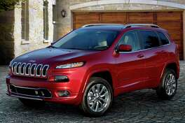 The new Jeep Cherokee Overland model comes with a host of premium features, including a powerful V-6 engine, a nine-speed automatic transmission, and off-road-capable four-wheel drive.