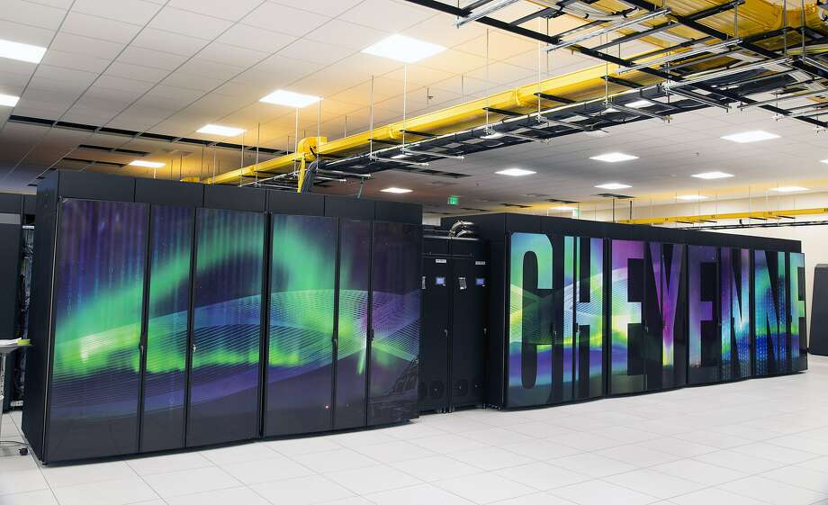 This Oct. 26, 2016 photo provided by the University Corporation for Atmospheric Research shows the new supercomputer named Cheyenne at the National Center for Atmospheric Research at the supercomputing center in Cheyenne, Wyo. Wyoming officials including Gov. Matt Mead say they support the NCAR-Wyoming Supercomputing Center even as they describe themselves as climate skeptics. Scientists nationwide are nonetheless concerned that President Donald Trump, who has called climate change a hoax, might not take climate change research seriously. (Carlye Calvin/ University Corporation for Atmospheric Research via AP) Photo: Carlye Calvin, Associated Press