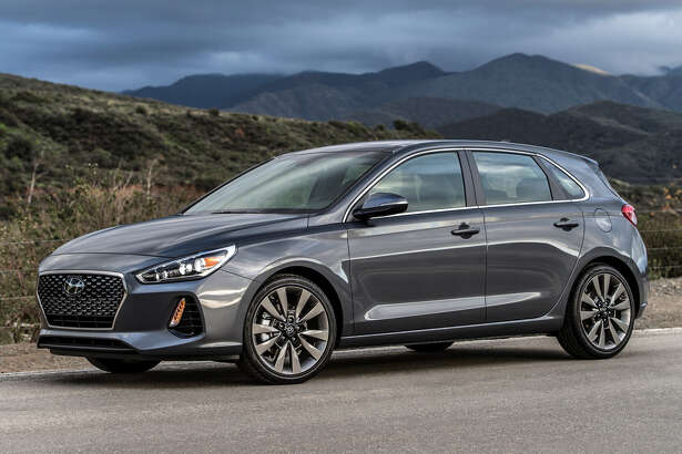 Longer and wider, the 2018 Hyundai Elantra GT hatchback could wind up being classified by the EPA as a large car.