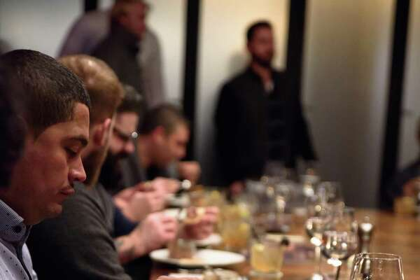 Guests at the bourbon dinner at Del Frisco's Grille in Stamford dig into the first course.