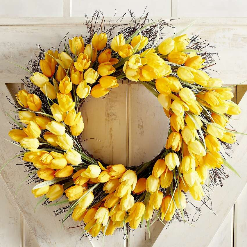 Nothing says spring like a ring of bright yellow tulips. This 22-inch handcrafted wreath is made from natural grapevine but faux flowers for durability. Use it indoors or in a covered spot outside. $39.95. pier1.com.