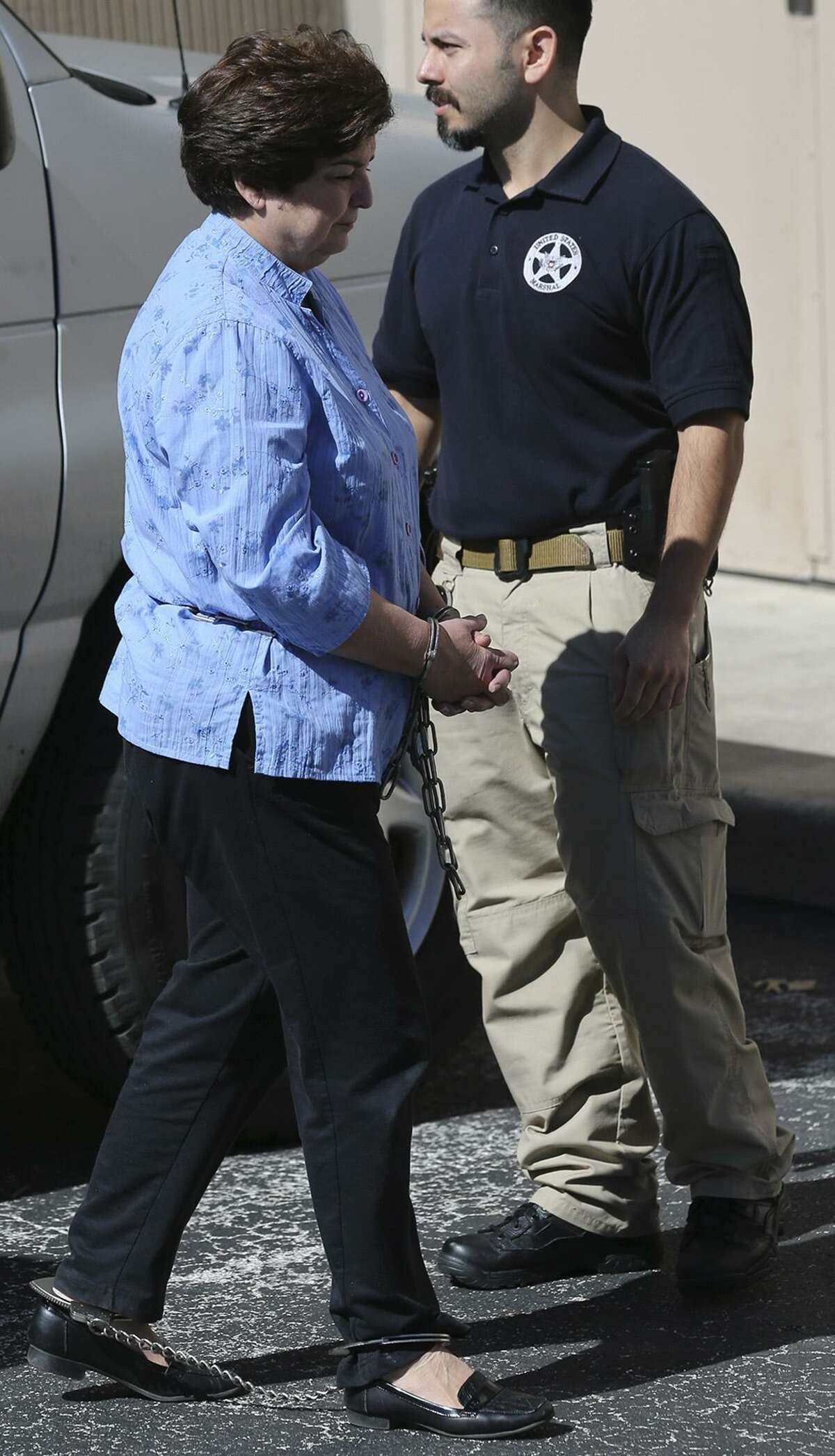 SAISD school board member Olga Hernandez (left) walks from a van Thursday February 16, 2017 to the John H. Wood, Jr. Federal Courthouse. Hernandez was picked up by the FBI in a public corruption case.