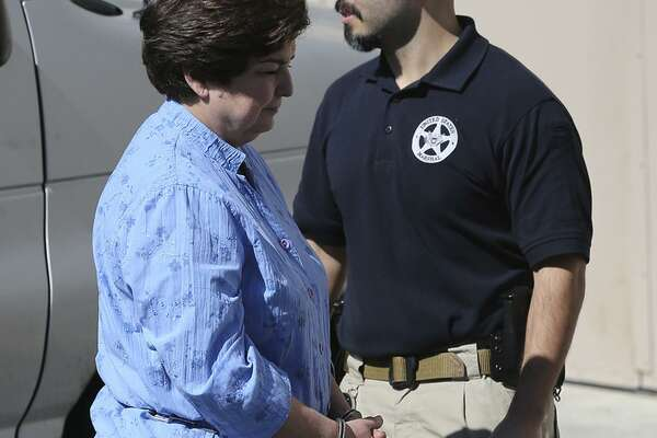 SAISD school board member Olga Hernandez (left) walks from a van Thursday February 16, 2017 to the John H. Wood, Jr. Federal Courthouse. Hernandez was arrested by the FBI in a public corruption case.