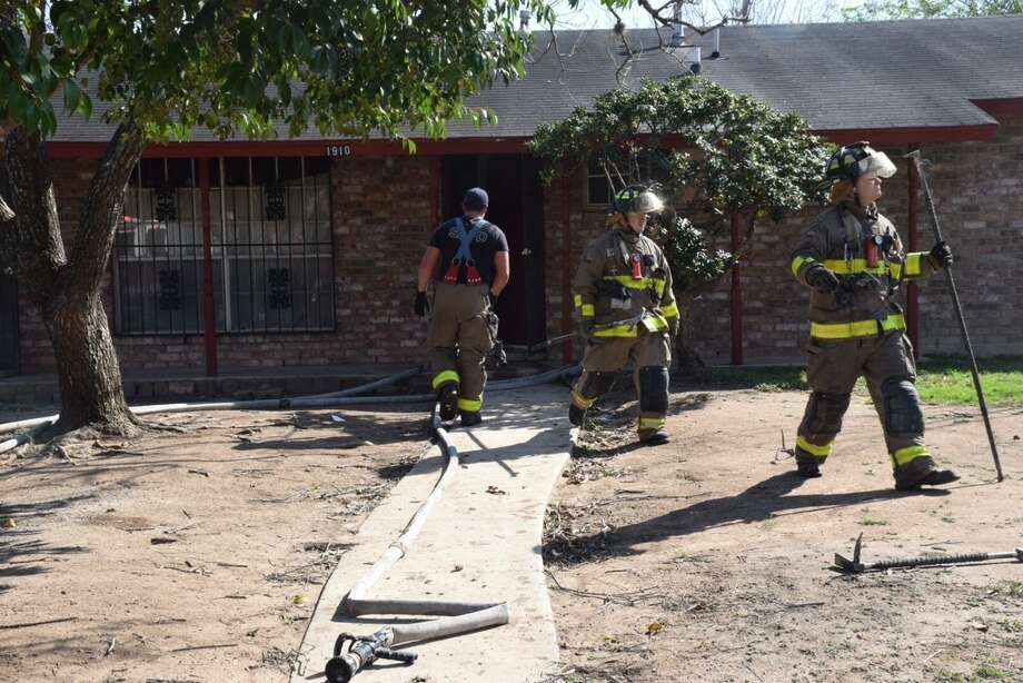 Firefighters responding to a house fire on the East Side Friday, Feb. 17, 2017, said they believe the blaze began when a resident tried to start a lawnmower too close to a water heater. Photo: Caleb Downs/San Antonio Express-News