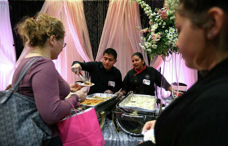 Servers from Los Chefs Hermanos Catering offer samples to potential quinceañera customers at an expo in Houston earlier this year. The city ranked No. 1 among U.S. cities for cultivating minority-owned businesses in a recent survey. Photo: Annie Mulligan, Freelance / 2016 Annie Mulligan