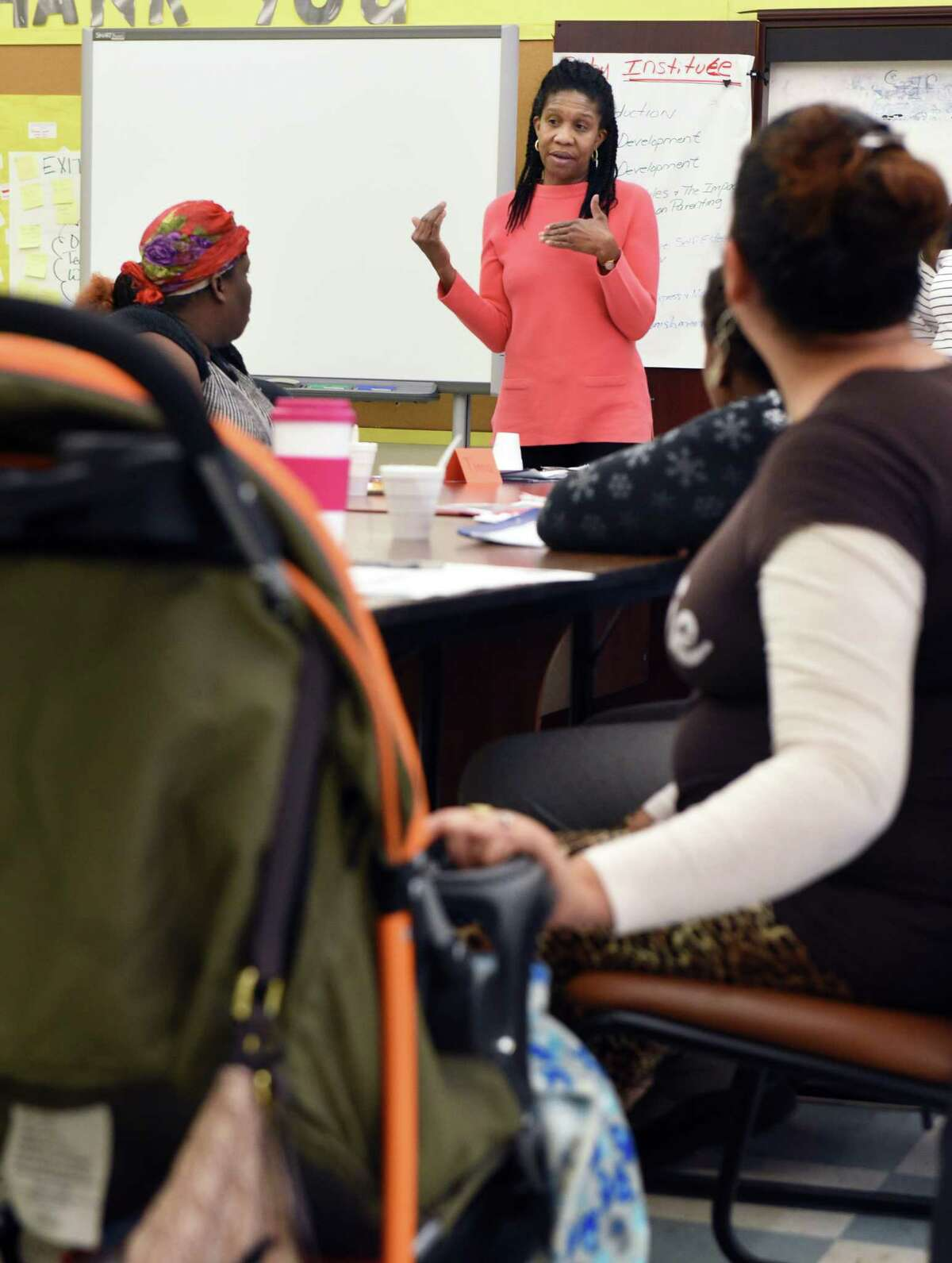 Noelene Smith, top, founder of The Baby Institute, during a class to teach parents child development, literacy and critical thinking so they may better prepare their children for preschool and kindergarten at Giffen Elementary School Saturday Jan. 28, 2017 in Albany, NY. Noelene's goal is for poor children to reach college. (John Carl D'Annibale / Times Union)