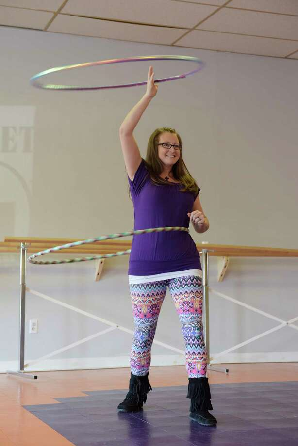 Jennifer Mapes, owner of Hoops by JEM, demonstrates a halo and waist hooping on Thursday, Jan. 26, 2017, in Delmar, N.Y.  Mapes hand makes the custom hula hoops.   (Paul Buckowski / Times Union) Photo: PAUL BUCKOWSKI / 20039513A