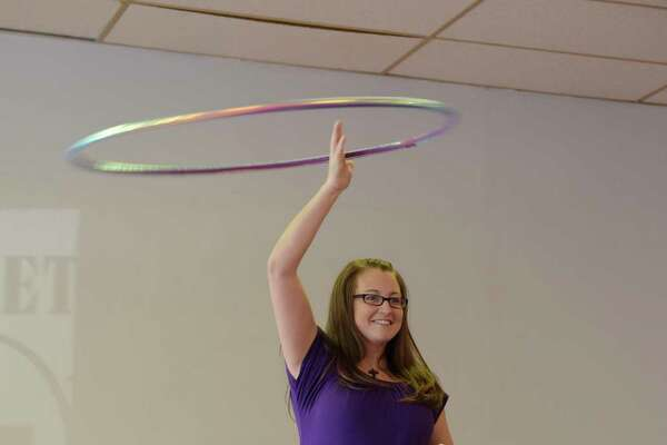 Jennifer Mapes, owner of Hoops by JEM, demonstrates a halo and waist hooping on Thursday, Jan. 26, 2017, in Delmar, N.Y.  Mapes hand makes the custom hula hoops.   (Paul Buckowski / Times Union)