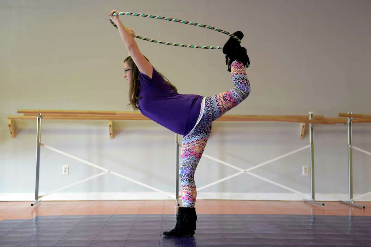 Jennifer Mapes, owner of Hoops by JEM, demonstrates how she'll use a hula hoop for a yoga stretch onThursday, Jan. 26, 2017, in Delmar, N.Y. Mapes hand makes the custom hula hoops. (Paul Buckowski / Times Union)