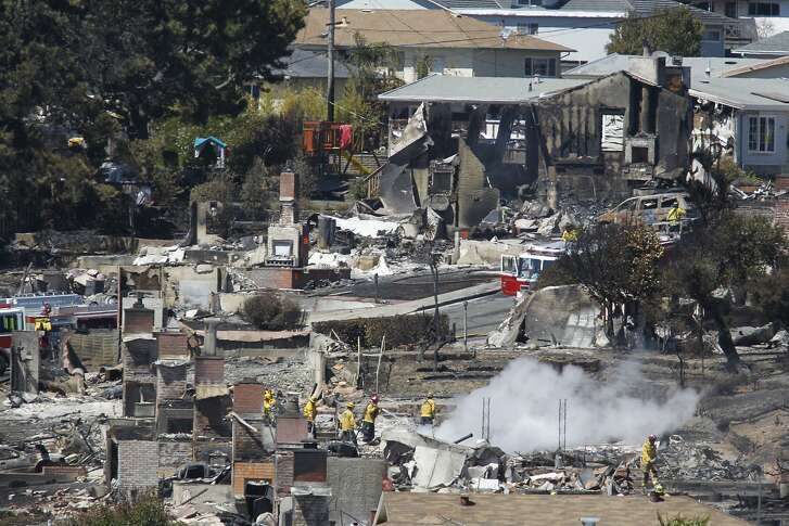 Fire fighters look through homes that were destroyed in a massive gasline explosion in San Bruno on Friday, Sept. 10, 2010.