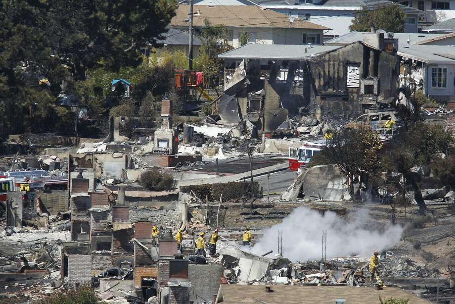 Firefighters look through homes that were destroyed in a massive PG&E gas-line explosion in San Bruno on Friday, Sept. 10, 2010. The explosion led to federal probe that led to the utility being convicted of five charges of failing to properly inspect and repair its aging pipelines and a sixth charge of interfering with the investigation. The company said Thursday, Feb. 16, 2016, that it would not appeal those convictions. Photo: Paul Chinn, The Chronicle