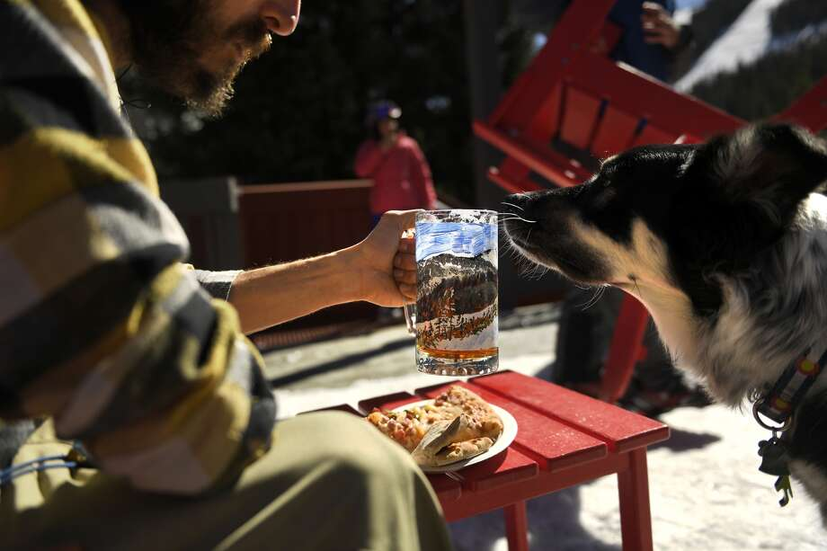 FREDERICK, CO FEBRUARY 16: Jeremiah Baltzer having a beer with his dog Miles in his new mug that was painted by his mom.