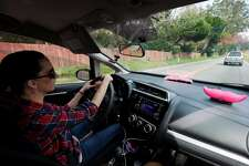 Brittney Barber drives to fill up her tank and buy coffee before starting her Lyft shift on Tuesday, Jan. 31, 2017 in Half Moon Bay, Calif. Barber, of Fresno, stays at her friend's house in Half Moon Bay to shorten her commute to San Francisco, where she works as a Lyft driver. On a typical week, she will stay in Half Moon Bay for a few days to work 40-50 hours in her grey Honda Fit and then go back home to her four children in Fresno.