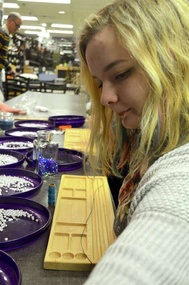 Amelie Khiar, 13, of New Canaan, donated her time to help with the bracelet-assembly project to benefit Stamford-based Pacific House, held at Art & Soul, Thursday, Feb. 16, 2017, in New Canaan, Conn. Photo: Jarret Liotta / For Hearst Connecticut Media / New Canaan News Freelance
