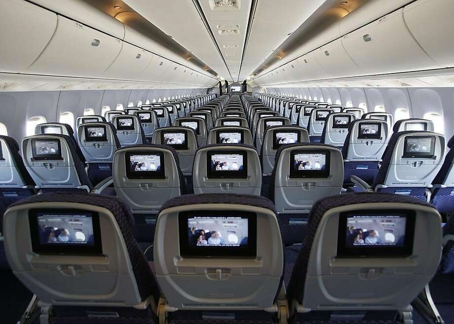 This is a reconfigured Economy cabin in a Boeing 767-300 aircraft, originally from the United fleet. We have completed two of 14 aircraft getting this particular retrofit. With this reconfiguration, every seat has personal, on-demand entertainment. There are power ports at every row, and the overhead bins are larger. Previously, the aircraft had smaller bins, no power ports, and the movies played from screens mounted to the ceilings. Photo: United Airlines Creative Service