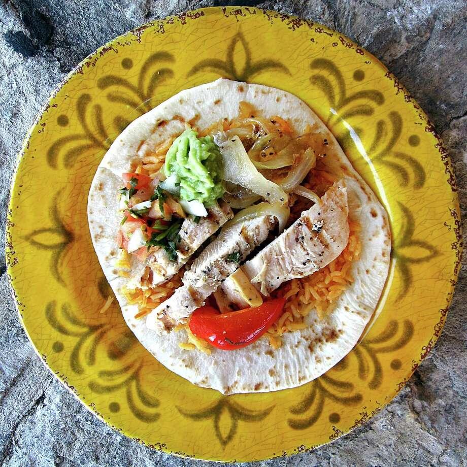 Chicken fajita taco on a handmade flour tortilla from Lisa's Mexican Restaurant. Photo: Mike Sutter /San Antonio Express-News