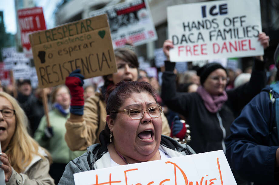 Protesters chant while marching in opposition of the arrest of DACA recipient Daniel Ramirez Medina, outside Seattle federal courthouse on Friday, Feb. 17, 2017. Photo: GRANT HINDSLEY, SEATTLEPI.COM / SEATTLEPI.COM