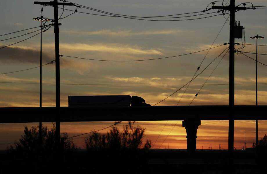 In 2016, a truck travels toward the World Trade Bridge in Laredo. President Donald Trump has injected too much uncertainty into NAFTA, which has been a net plus for Southwestern states such as Texas. Photo: Eric Gay /Associated Press / Copyright 2016 The Associated Press. All rights reserved.