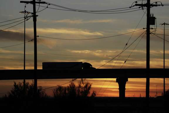 In this Monday, Nov. 21, 2016 photo, a truck travels on an overpass towards the World Trade Bridge, in Laredo, Texas. San Antonio may be getting an unexpected shot of investment as Mexicans seek to set up operations in the U.S. ahead of NAFTA talks.